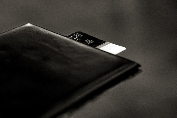 Photo of a credit card in a restaurant bill sleeve