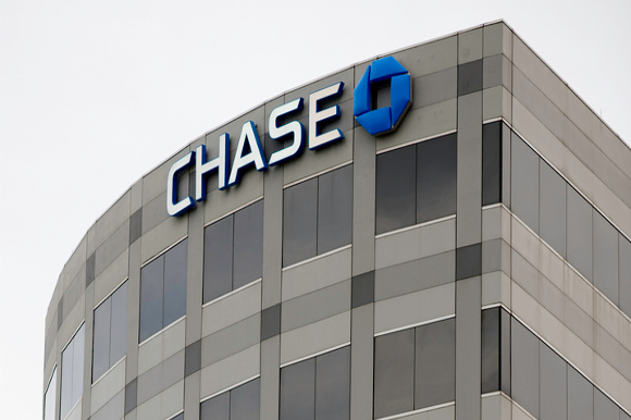Color photo of the Chase logo on the top of a building